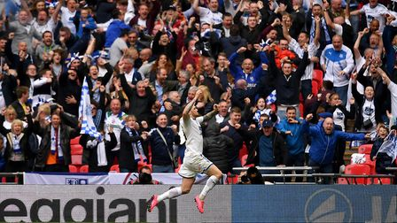 James Norwood celebrates with the Tranmere fans after firing the club into the Football League in Ma
