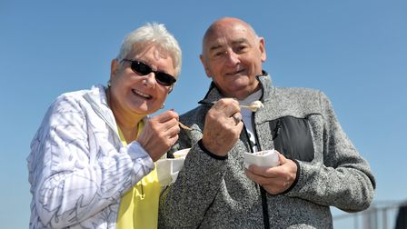Val and Stan Bird enjoy an ice cream at Aldeburgh beach Picture: SARAH LUCY BROWN