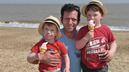 William, Dan and Michael Hall having an ice cream on the beach - will you be heading to the coast th