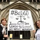 Anne Taylor (left) and Patsy Franklin from the campaign 'Back to 60' outside the Royal Courts of Jus