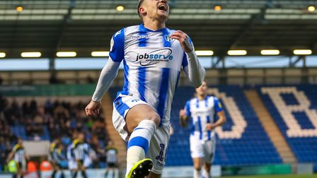 A familiar sight: Sammie Szmodics jumps for joy after scoring on home turf for Colchester United, th