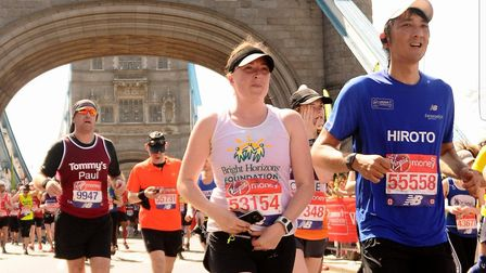 Sam Walker, of Great Cornard, who will be running 10 marathons in 10 days for charity, runs over Tow