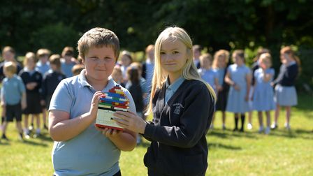 Keiron Humphrey and Lucinda Garnham with their Lego model Picture: SARAH LUCY BROWN