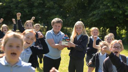 Children at Orford Primary School celebrate the news that they have won lots of Lego Picture: SARAH