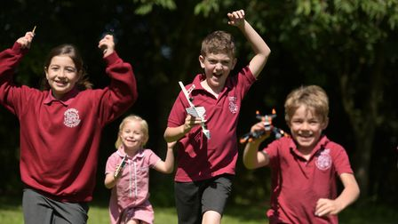 Children at Charsfield Primary School celebrate the news that they have won lots of Lego Picture: SA