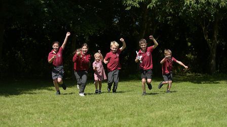 Children at Charsfield Primary School celebrate the news that they have won lots of Lego Picture: S