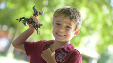 Children at Charsfield Primary School celebrate the news that they have won lots of Lego. Logan wit