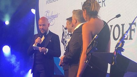 Comedian Tom Allen announces Timberwolf of Stowmarket as winners of the large business category at t