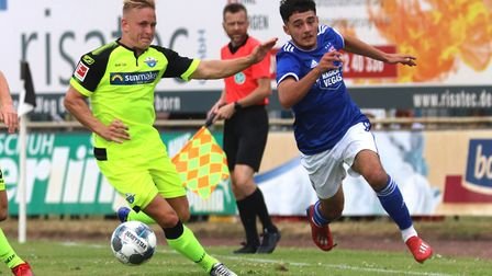 Armando Dobra battles for the ball during the pre-season friendly against Paderborn Picture: ROSS HA