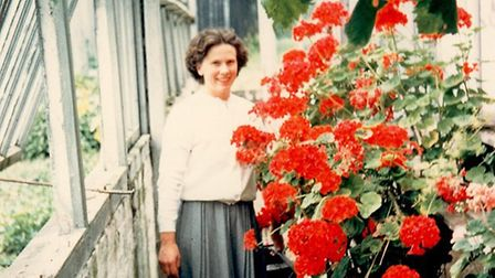 Pat in the greenhouse in 1960. She was a keen grower of plants Picture: FAMILY COLLECTION