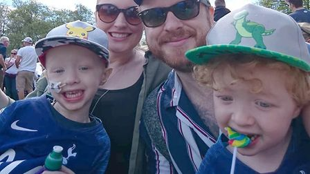 Archie Wilks (left) with family, twin brother Henry and parents Simon and Harriet Picture: WILKS FAM