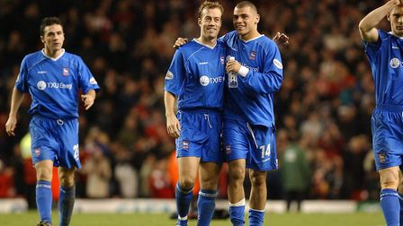 Give us a smile: Jamie Clapham (second left) is consoled by Jermaine Wright as the Ipswich players l