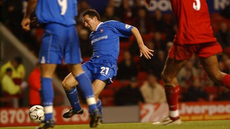 Tommy Miller directs home a shot to put Town 1-0 up at Anfield, in a Worthington Cup tie in 2002