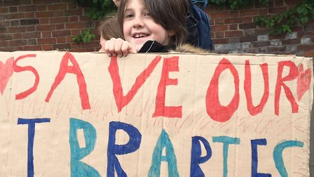Pickets emblazoned with slogans were carried by children fighting to save their libraries in Colches