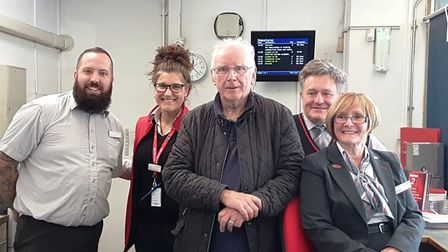 Pete Waterman with customer service staff at Colchester station ticket office. Picture: GREATER ANGL