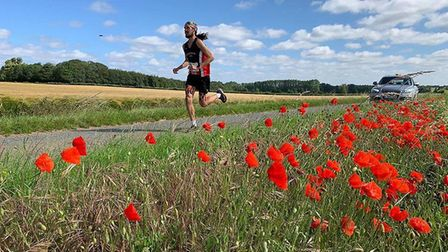 Adam Holland running through the scenic West Suffolk countryside during the recent Great Barrow 10 i
