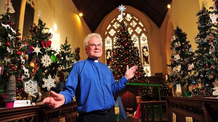 Reverend Michael Eden amongst the beautiful trees at the 2017 Christmas Tree Festival. Picture: SAR