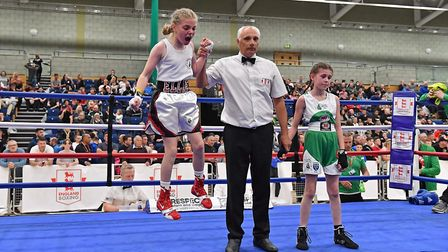 Suffolk boxer Ellie Mateer, left, celebrates a victory. Picture: ANDY/SAM CHUBB