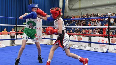 Ellie Mateer, right, lands a punch during a fight. Picture: ANDY/SAM CHUBB