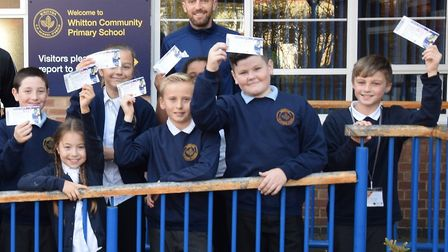 Cole Skuse giving Whitton Community Primary School children free tickets to a game last season. Pict