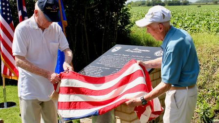 Bill Hennessy, left, and Dick Nelms unveil the memorial at Hitcham Picture: CHRIS FRENCH
