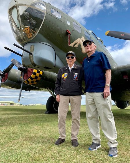 Dick Nelms, left, and Bill Hennessy with the B17 Flying Fortress at IWM Duxford Picture: CHRIS FRENC