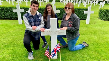 Pam Saunders with her grandchildren Aidan Saunders, left, and Aeryn Saunders at the grave of her fat