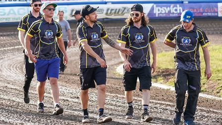 The Ipswich Witches team walk the track ahead of their loss to the Poole Pirates. Picture: STEVE WAL