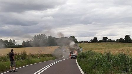 The vehicle caught fire on the A1071 between Sudbury and Boxford. Picture: JANE RYLAND