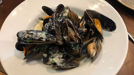 Mark's starter at The Angel Hotel - moules mariniere. Not bad, but a huge portion. Picture: MARK HEA
