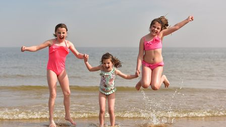 Frinton beach packed with visitors soaking up the sun - from left, Hannah Hazel, Josie and Lucy-Jo R