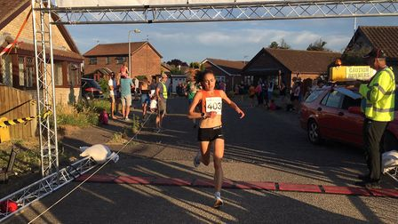 Laura Thomas approaches the finish-line to take first spot in the ladies' race at the Great Bentley