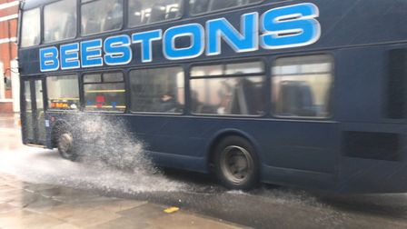 A bus going through a large puddle during Storm Gareth's rain in Ipswich Picture: ELLA WILKINSON