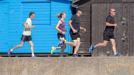 Runners pass in front of the beach huts during Saturday's Clacton Seafront parkrun. Picture: CLACTON