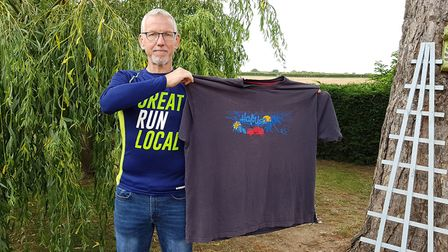 Gary Edwards posing with the XXXXXL T-shirt he used to wear Picture: RACHEL EDGE