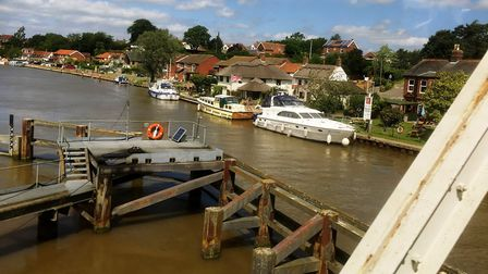 The Lowestoft to Norwich line beside the southern broads and passing over Reedham Swing Bridge is th