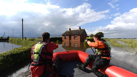Rescue workers in Wainfleet All Saints, in Lincolnshire, where streets and properties are flooded Pi
