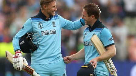 England's Joe Root (left) and Eoin Morgan celebrate victory against Australia. Picture: PA SPORT