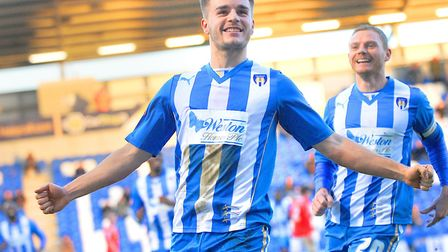 Luke Garbutt, set to sign for Ipswich Town, celebrates scoring for Colchester United against Crewe,