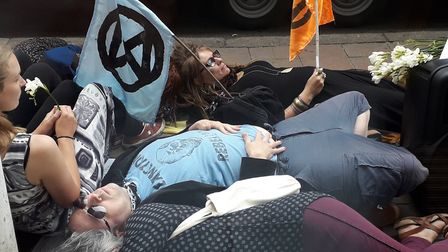 Extinction Rebellion accuse the banking industry of playing a part in worldwide damage to the enviro