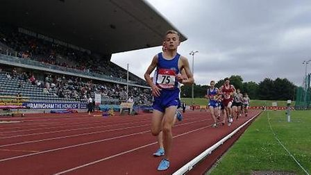 Lewis Sullivan sets the pace in the final of the 1,500m at the English Schools Championships in Birm