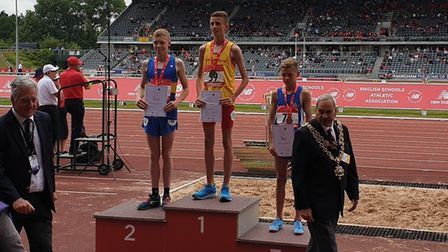 On the rostrum: Lewis Sullivan, far right, receives his bronze medal with winner Joshua Blevins (cen