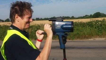 A member of the Safety Camera Partnership Team using the speed camera. Picture: SUFFOLK CONSTABULARY
