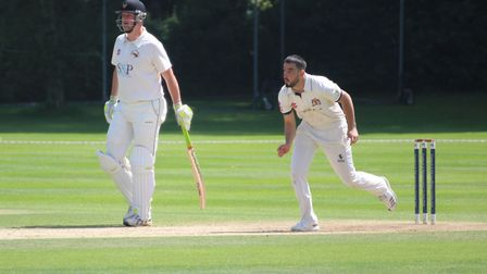 Australian Cameron Valente, bowling, who took four wickets and top-scored with 58 in Copdock & OI's