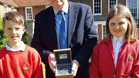 Terry Hunt, with his Suffolk Medal, alongside pupils from Earl Soham school Picture: RACHEL EDGE