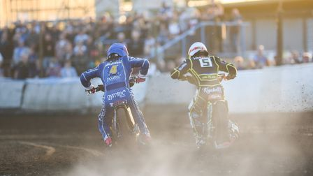 Thomas Jorgensen and (right) Krystian Pieszczek fly out of the gate in heat nine at Lynn. Photo: IAN