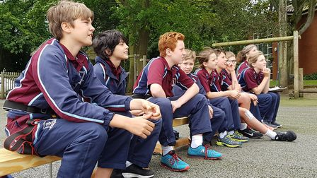Pupils watch on as children take on the climbing wall Picture: RACHEL EDGE