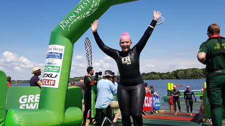 Swimmers celebrated crossing the finish line the Great East Swim at Alton Water Park, Suffolk. Pictu