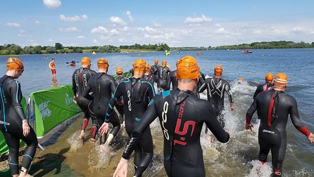 Every swimmer wore a wet suit and a coloured hat depending on which race they were doing. Picture: R