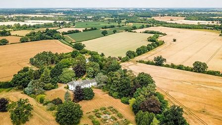 The 14 acres include a tennis court, a swimming pool and a separate cottage. Picture: JACKSON-STOPS